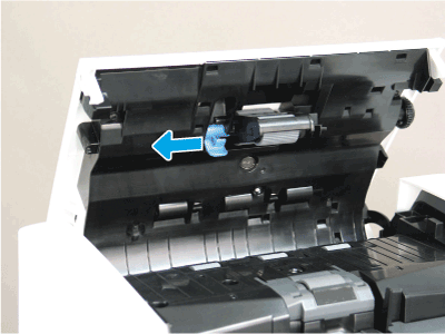 Slide the locking lever toward the front of the printer