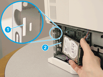 Locate the slot where the HDD mounting tab is installed