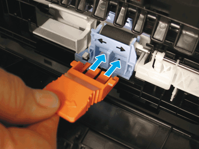 Install the orange tool in the separation roller