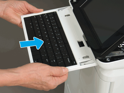 Slide the keyboard tray into the slot