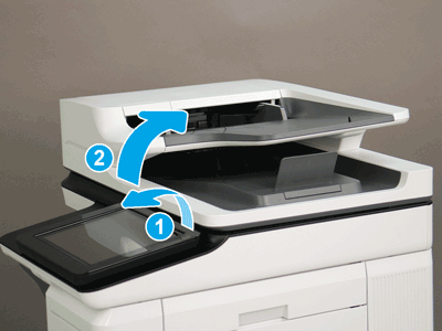Tilt the control panel and open the document feeder
