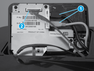 Disconnect the USB cables and wire harness