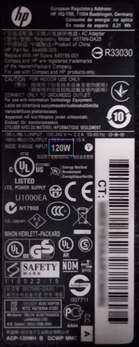 Power adapter label with wattage highlighted