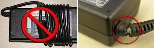 アダプターに巻き付きついた電源コード、および破損したアダプターコード