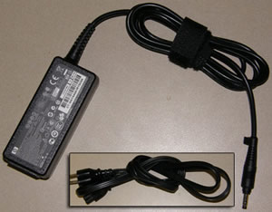 Adaptador e cabo de alimentação devidamente enrolado para armazenamento