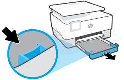 Wciśnięcie przycisku blisko przedniej lewej strony podajnika