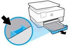 Pressing button near the front left of the tray