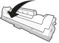 Sacudir el cartucho de tóner suavemente