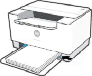 Deslizar las guías del papel