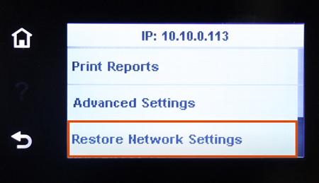 Ejemplo de seleccionar Restaurar configuración de red en el panel de control de la pantalla táctil