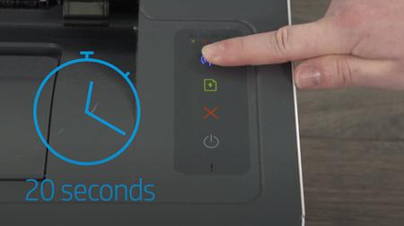 Przykład naciśnięcia i przytrzymania przycisku Komunikacja bezprzewodowa przez 20 sekund