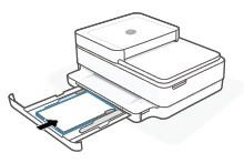 Inserting a stack of plain white paper into the input tray